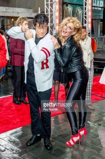 Hosts Savannah Guthrie and Carson Daly dressed as Sandy Olsson and Danny Zuko of Grease during NBC's Today Halloween Celebration at Rockefeller Plaza...