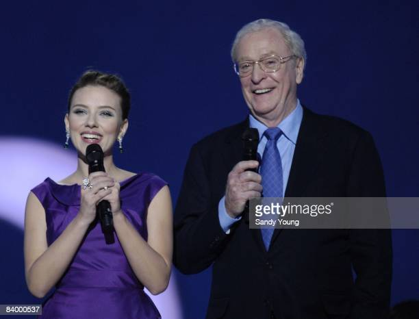 Hosts Scarlett Johansson and Sir Michael Caine introduce the acts during the The Nobel Peace Prize Concert 2008 at the Oslo Spektrum on December 11,...