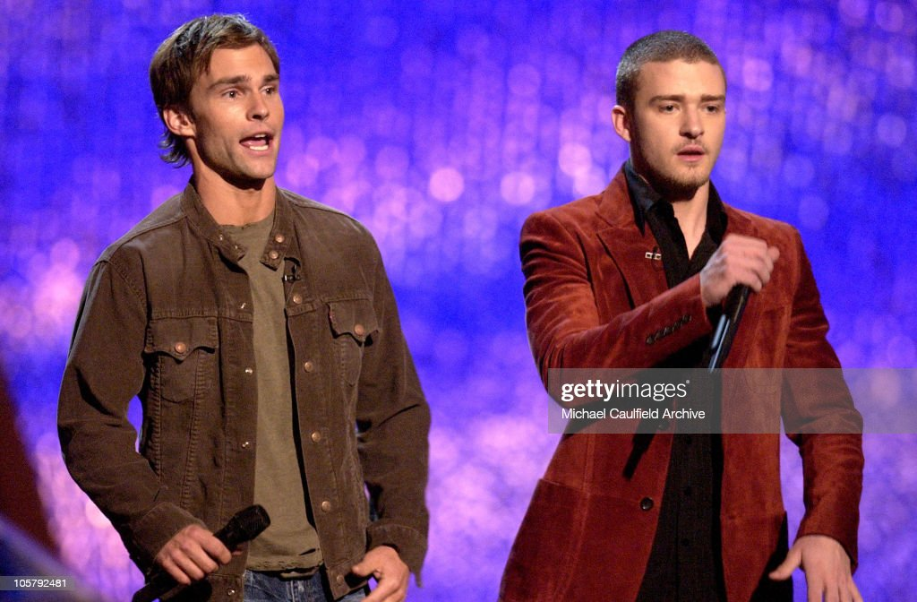 Hosts Seann William Scott and Justin Timberlake during 2003 MTV Movie Awards - Show at The Shrine Auditorium in Los Angeles, California, United States.