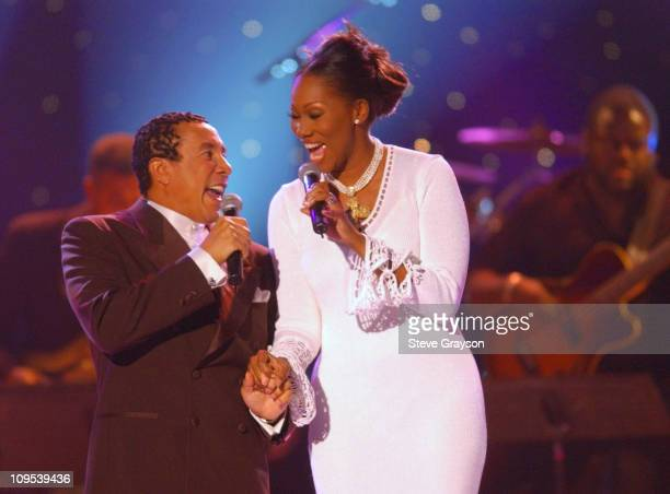 Hosts Smokey Robinson and Yolanda Adams during their opening duet performance during a taping for the 2001 Soul Train Christmas Starfest at the Santa...