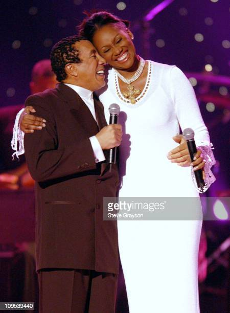 Hosts Smokey Robinson and Yolanda Adams smile after their opening duet performance during a taping for the 2001 Soul Train Christmas Starfest at the...