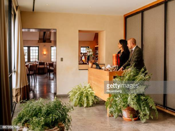 Hosts stand at the reception desk of the Blue Hill at Stone Barns restaurant in Pocantico Hills New York US on Friday April 21 2017 As customers are...