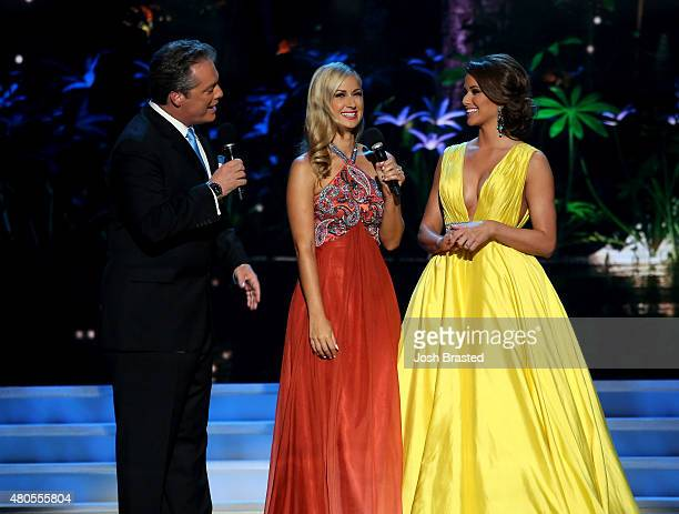 Hosts Todd Newton and Former Miss Wisconsin Alex Wehrley onstage with Miss USA 2014 Nia Sanchez at the 2015 Miss USA Pageant Only On ReelzChannel at...