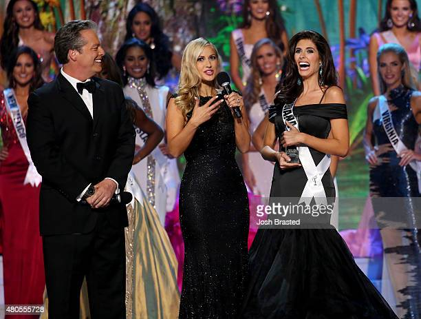 Hosts Todd Newton and Former Miss Wisconsin Alex Wehrley speak with Most Photogenic winner Miss Montana Tahnee Peppenger on stage at the 2015 Miss...