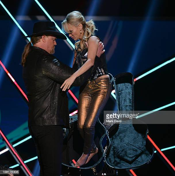 Hosts Trace Adkins and Kristin Chenoweth speak onstage during the 2012 American Country Awards at the Mandalay Bay Events Center on December 10 2012...