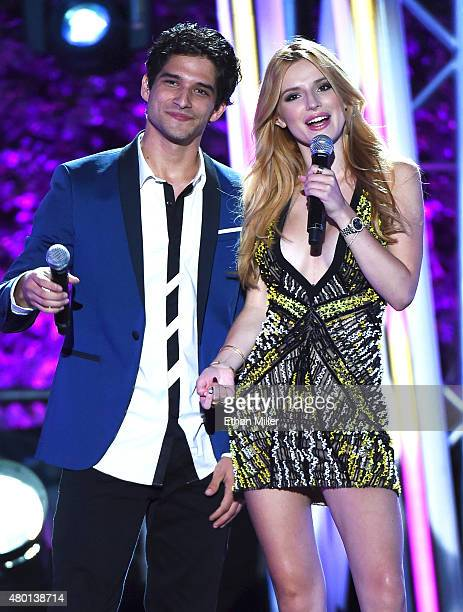 Hosts Tyler Posey and Bella Thorne perform onstage during the MTV Fandom Fest San Diego ComicCon at PETCO Park on July 9 2015 in San Diego California