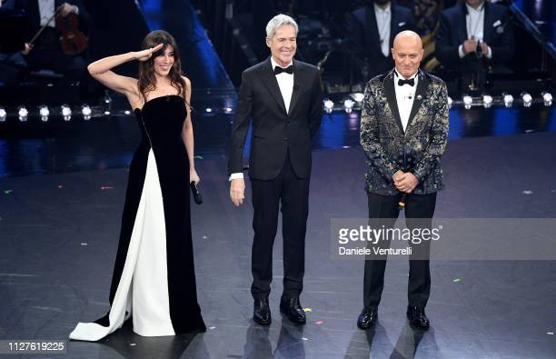 Hosts Virginia Raffaele Claudio Baglioni and Claudio Bisio on stage during the first night of the 69th Sanremo Music Festival at Teatro Ariston on...