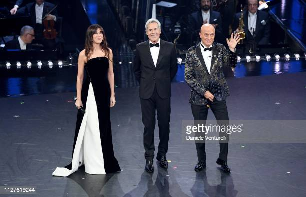 Hosts Virginia Raffaele Claudio Bisio ands Claudio Baglioni on stage during the first night of the 69th Sanremo Music Festival at Teatro Ariston on...