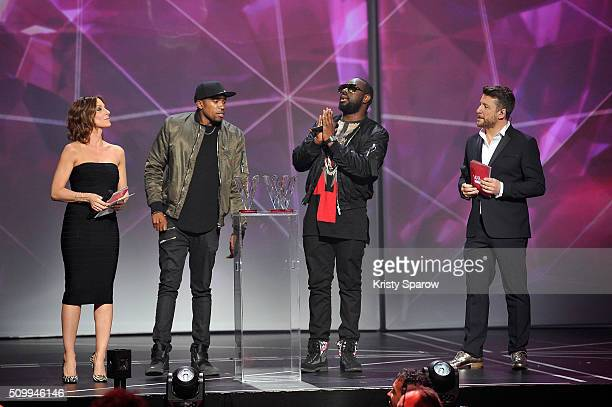 Hosts Virginie Guilhaume and Bruno Guillon present Niska and Gandhi Djuna better known by his stage name Maitre Gims with the award for Song of the...