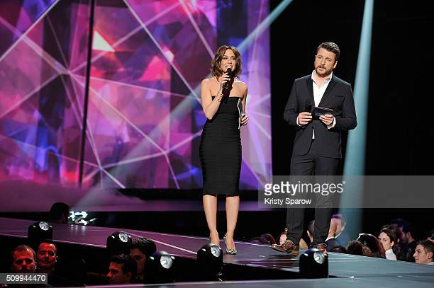 Hosts Virginie Guilhaume and Bruno Guillon speak onstage during the 31st 'Victoires de la Musique' French Music Awards Ceremony at Le Zenith on...