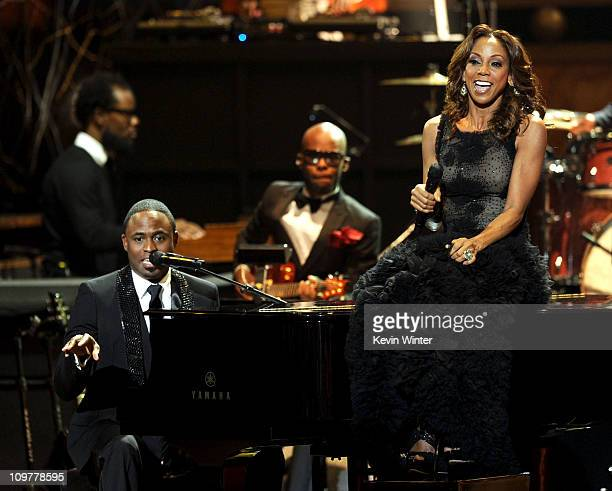 Hosts Wayne Brady and Holly Robinson Peete perform onstage at the 42nd NAACP Image Awards held at The Shrine Auditorium on March 4 2011 in Los...