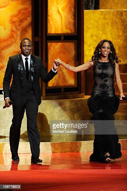 Hosts Wayne Brady and Holly Robinson Peete speak onstage at the 42nd NAACP Image Awards held at The Shrine Auditorium on March 4 2011 in Los Angeles...