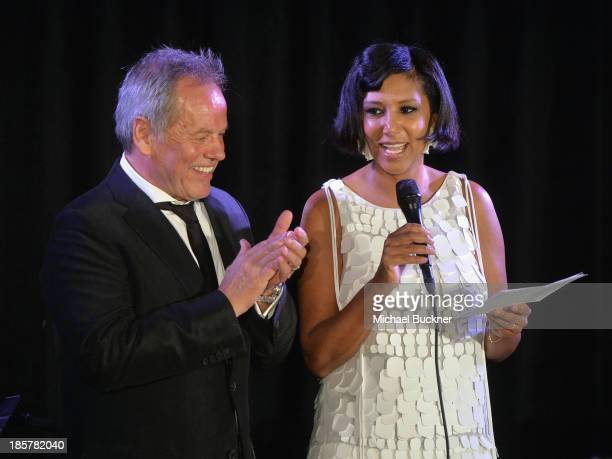 Hosts Wolfgang Puck and Gelila Assefa Puck speak onstage during Dream for Future Africa Foundation Inaugural Gala honoring Franca Sozzani of VOGUE...