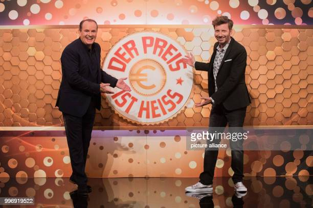 Hosts Wolfram Kons and Thorsten Schorn stand on stage during the recording of the RTL game show 'Der Preis ist heiss'in Cologne Germany 17 July...