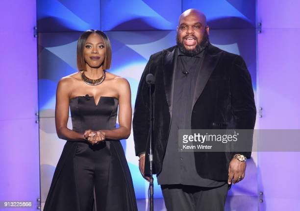 Hosts Yvonne Orji and Pastor John Gray speak onstage during BET Presents 19th Annual Super Bowl Gospel Celebration at Bethel University on February 1...