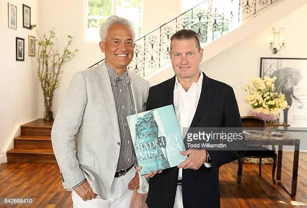 Hosts/designers Mark Badgley and James Mischka attend the Badgley Mischka book signing to celebrate Badgley Mischka American Glamour on June 23 2016...