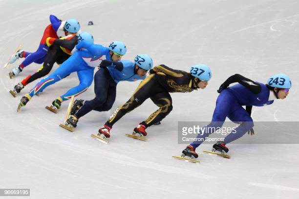 HoSuk Lee of South Korea leads the pack in the Short Track Men's 1500 m Heat on day 2 of the Vancouver 2010 Winter Olympics at Pacific Coliseum on...