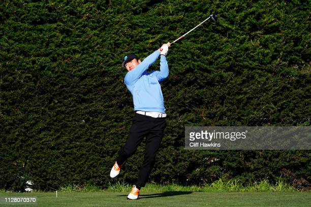 Hosung Choi of South Korea plays his shot from the second tee during the first round of the ATT Pebble Beach ProAm at Monterey Peninsula Country Club...