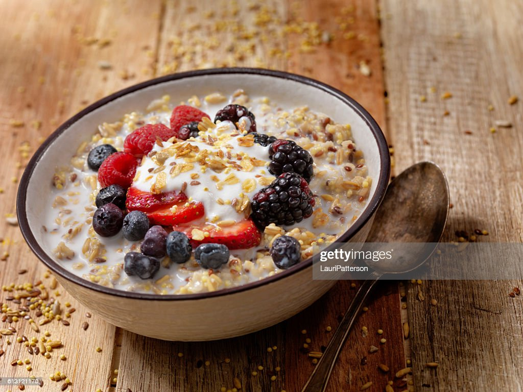 Hot 7 Grain Breakfast Cereal With Yogurt and Fresh Fruit : Stock Photo