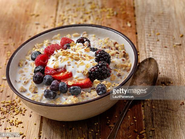 hot 7 grain breakfast cereal with yogurt and fresh fruit - cereal plant stock pictures, royalty-free photos & images