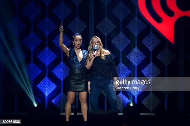 Hot 99.5's Elizabethany and the Capital One winner speak onstage during Hot 99.5's Jingle Ball 2017 Presented by Capital One at Capital One Arena on...