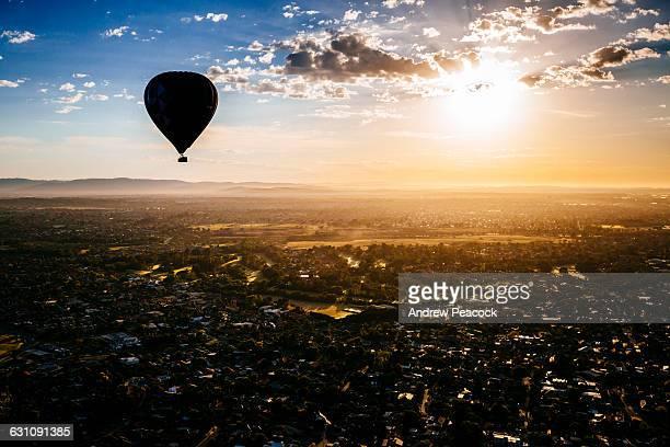 A hot air balloon above the suburbs