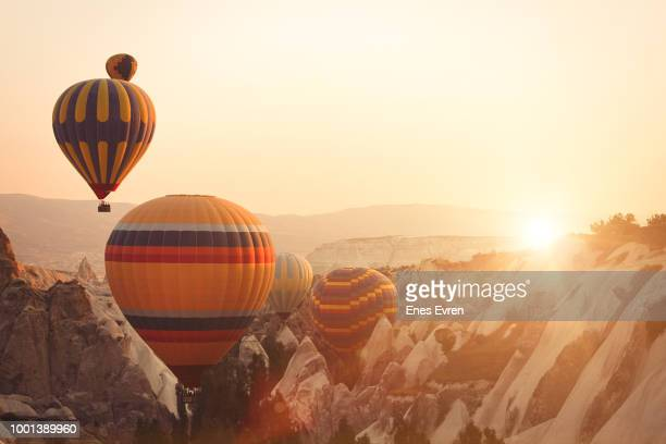 hot air balloon and fairy chimneys in cappadocia - balloon ride stock pictures, royalty-free photos & images