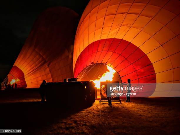 hot air balloon at night - inflating stock pictures, royalty-free photos & images