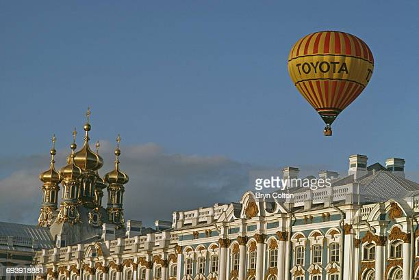 A hot air balloon carrying the Toyota Motor Corp logo flies above Catherine's Palace to compete in the first free flights into Soviet airspace during...