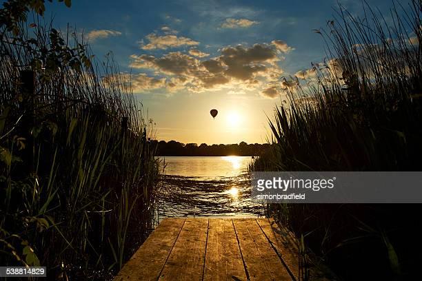 Hot Air Balloon Drifting Over Lake