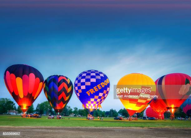 hot air balloon festival night glow #2 - flame monroe stock photos and pictures