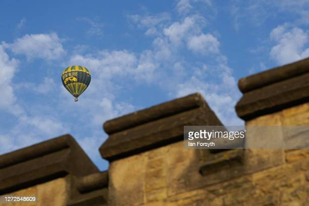 Hot air balloon flies over the city walls of York on September 15, 2020 in York, England.