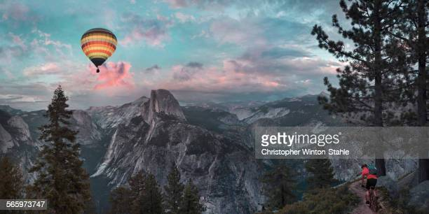 Hot air balloon floating over half dome in Yosemite, United States