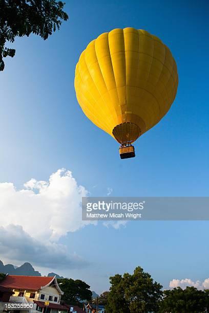 A hot air balloon floats away.