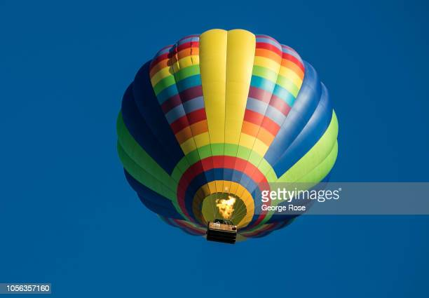 A hot air balloon floats over a Russian River Valley vineyard on September 21 near Healdburg California A cool spring and mild summer have...