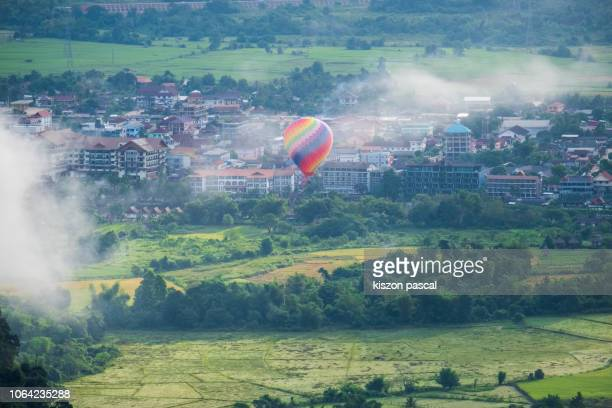 Hot air balloon flying in Vang Vieng during morning , Vientiane Province , Laos