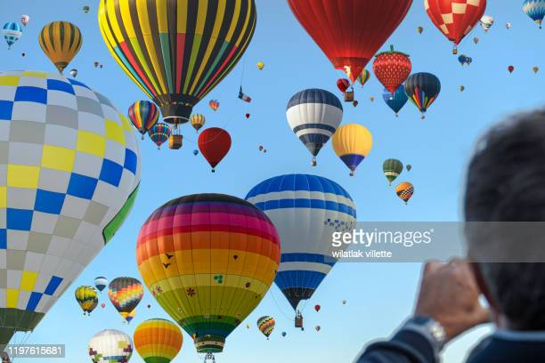 hot air balloon flying on sky balloon carnival chambley,lorraine,france - international match photos et images de collection