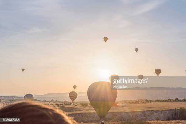Hot air balloon flying over Cappadocia at morning