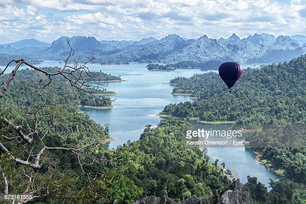 hot air balloon flying over khao sok national park - kao sok national park stock pictures, royalty-free photos & images