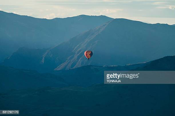 Hot air balloon flying over mountain range at Queenstown