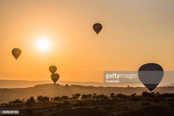 Hot air balloon flying over rock landscape at Cappadocia Turkey