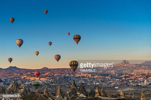 Hot air balloon flying over spectacular Cappadocia.