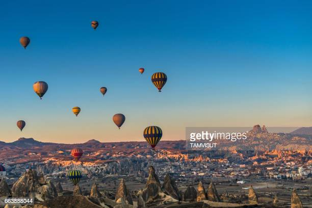Hot air balloon flying over spectacular Cappadocia.