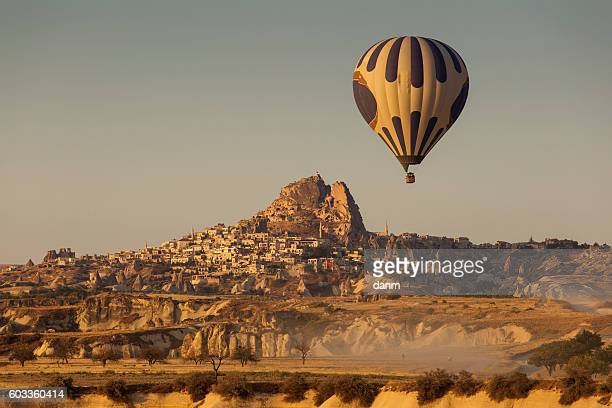 Hot air balloon flying over spectacular Cappadocia - Uchisara village
