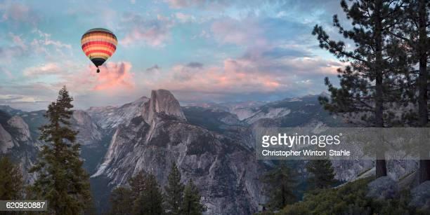 Hot air balloon flying over Yosemite, California, United States