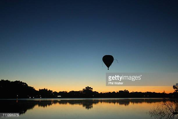 A hot air balloon flys over the Hamilton lake after leaving from Innes Common at dawn on the second day of the Balloons Over Waikato Hot Air Balloon...