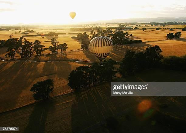 Hot Air Balloon glides across the Wairarapa plains as part of the mass ascension during the Wairarapa International Hot Air Balloon Festival at...