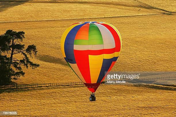 Hot Air Balloon glides across the Wiararapa Plains as part of the mass ascension during the Wairarapa International Hot Air Balloon Festival at...