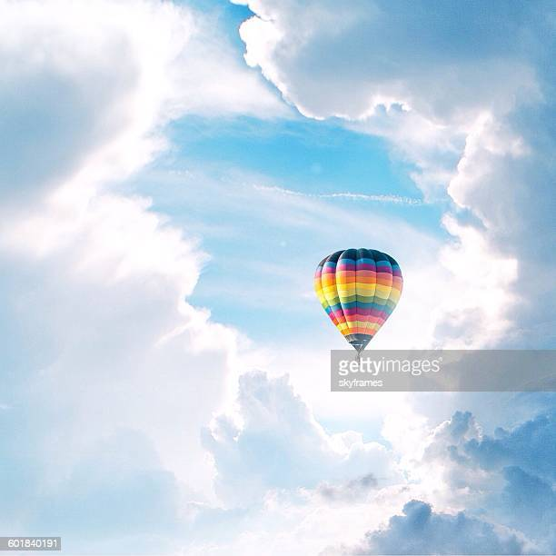 hot air balloon in clouds - hot air balloon stock pictures, royalty-free photos & images