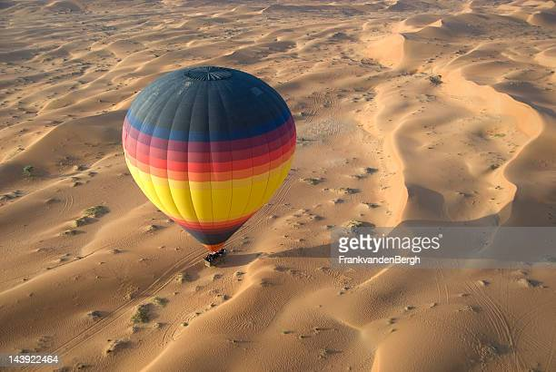 hot air balloon in desert - hot air balloon stock pictures, royalty-free photos & images